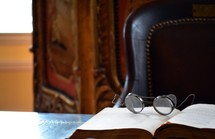 vintage spectacles on an open book