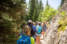 a group of people hiking on a trail