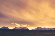 snow on mountain peaks at sunset