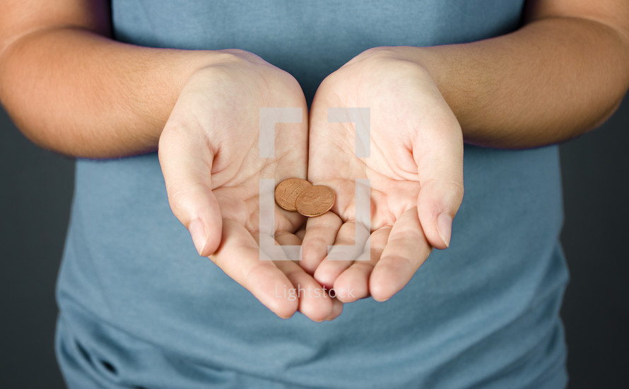 Much like the widow with her two small coins, a young girl holds out two pennies