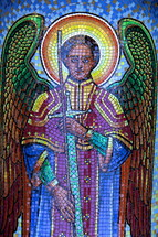 mosaic tile of an angel holding a sword