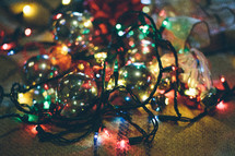 Christmas chaos - ornaments and lights in a pile