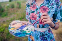 woman holding an paint palette