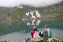 two women looking out at a lake, Hiking, Missions trip