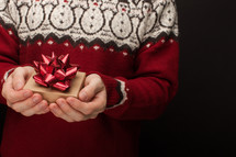 a man holding a Christmas gift box