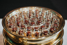communion wine cups in a tray