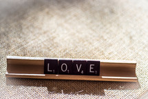 word love in scrabble pieces