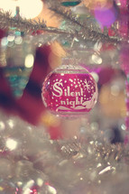 Silent Night Christmas ornament on a Christmas tree