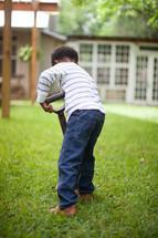 toddler boy with a shovel