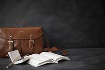 journal, purse, open Bible, pencil
