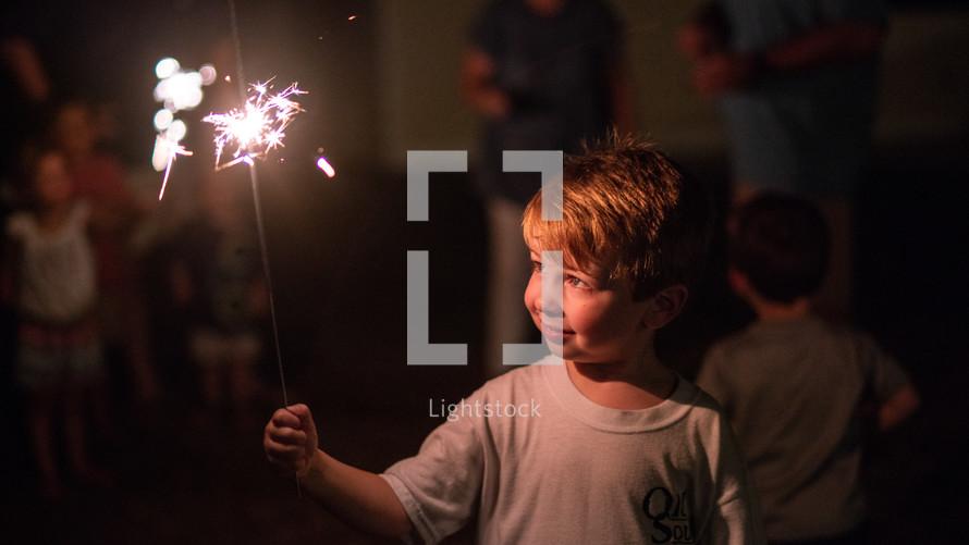 a child holding a sparkler