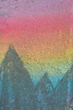 artwork in sidewalk chalk mountain peaks in nature against a gradient sky at sunrise with copy space