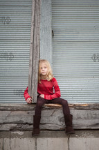 girl child sitting outdoors