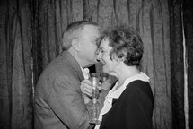 an elderly couple toasting on their anniversary