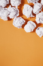 paper balls against an orange background