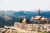 People on a mountain overlook.