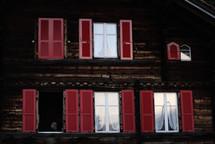 red shutters on a window