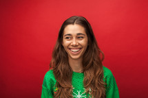 headshot of a smiling woman in a Christmas shirt