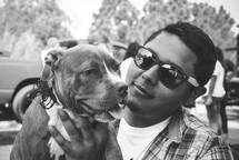 A man holding a dog.