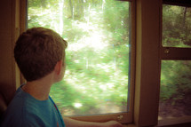 a boy looking out of a window