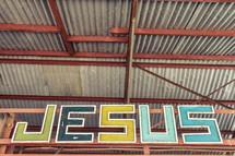 word Jesus, metal sign