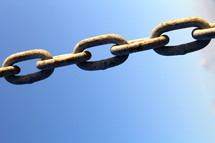 old rusty chain and blue sky
