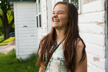 a teen girl laughing