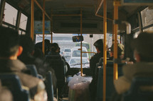Passengers on a bus.