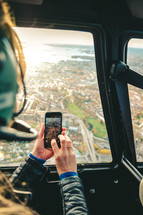 taking a picture out of a helicopter window