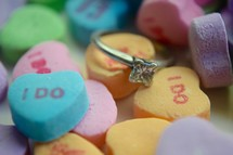 Valentines conversation hearts and diamond engagement ring