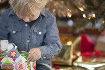 A child opening a Christmas gift.