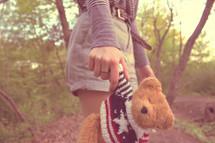 hand holding a teddy bear