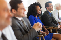 men and women listening to a business meeting