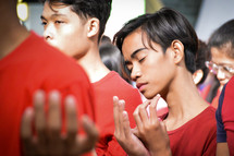 young men in prayer during a worship service