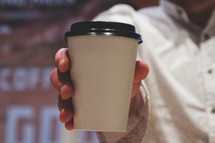 man holding a coffee cup