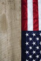 American flag hanging on wood.
