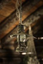 cobwebs on an old hanging lantern