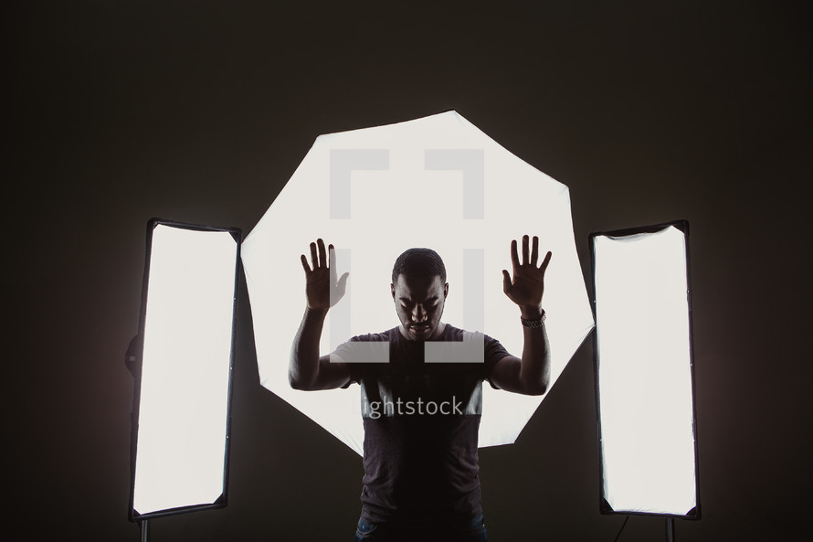 man with hands raised in worship