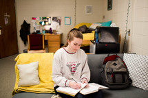 college student studying in her dorm room