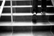 woman's feet walking up steps