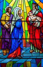 Mary, Joseph, and wise man holding baby Jesus stained glass window