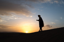silhouette of a man in a desert