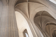 arched ceiling and tall windows in a cathedral