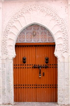 Wooden door to a mosque entrance.