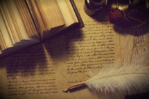 feather pen and calligraphy manuscript