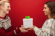 a couple giving Christmas presents
