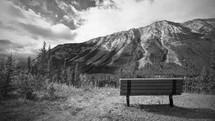 bench looking out at a mountain peak