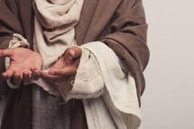 Joseph with palms up