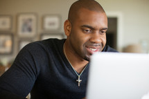 African-American man looking at a computer screen