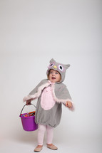 a toddler girl in a Halloween costume